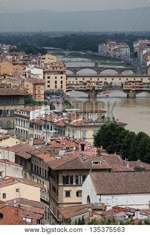 Landscape of Florence with historical medieval bridge on the Arno river ponte Vecchio Italy
