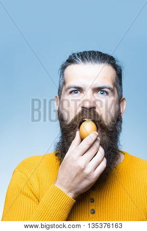 Serious Bearded Man With Egg