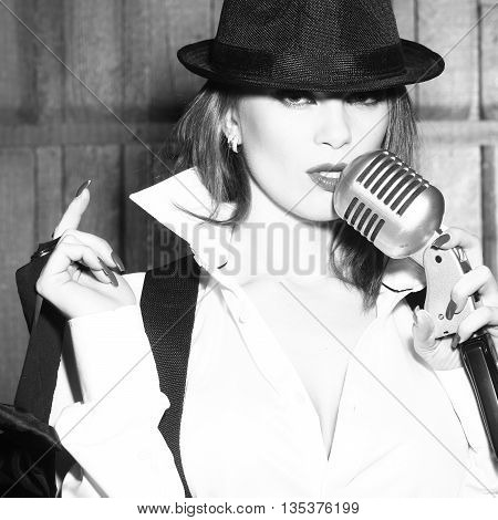 Retro Woman Singing Into Microphone
