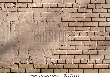 Space for the inscription on beige brick wall