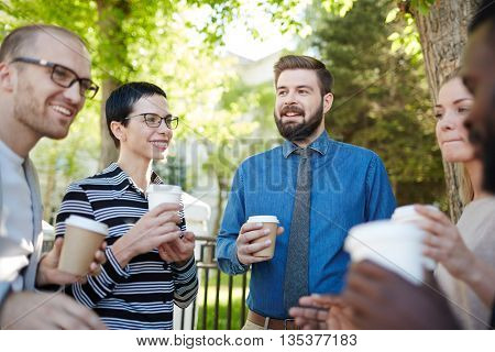 Having drink and discussing business strategies outdoors