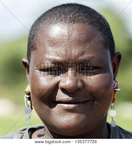 AFRICA, TANZANIA, MAY, 05, 2016 - Maasai tribe woman close-up in Tarangire National Park, Tanzania.
