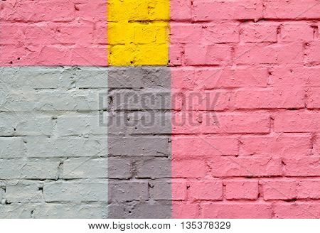 Colorful (pink yellow blue and grey) brick wall as background texture