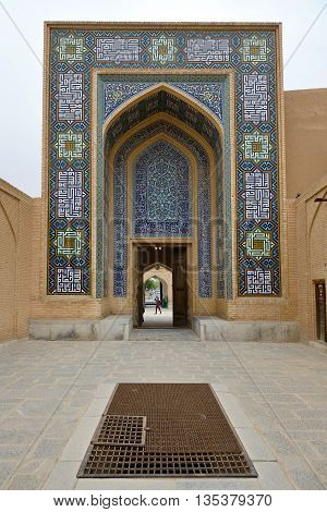 YAZD - APRIL 17: Back entrance of Jame Mosque in Yazd southern Iran on April 17 2015. The Jame Mosque of Yazd is the grand congregational mosque of Yazd city within the Yazd Province of Iran