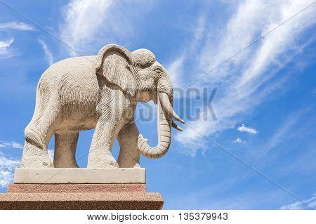 Carved sandstone elephant on blue sky background