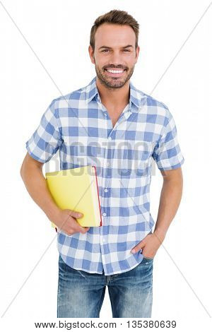 Portrait of happy young man holding folder on white background