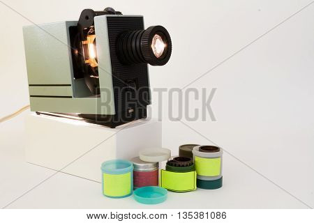 Old slide projector reels with films in cases