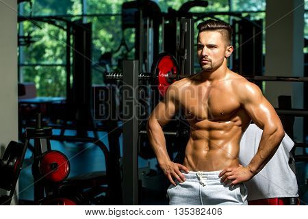 Muscular Man With Barbell