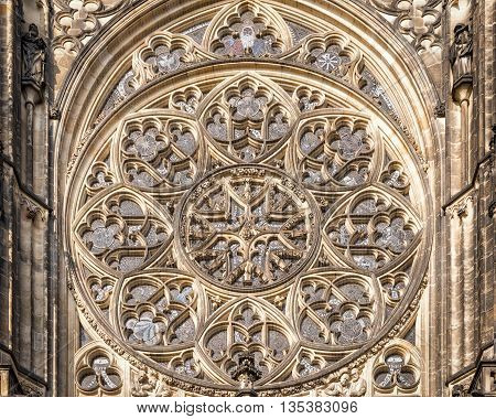 Prague Czech Republic - May 26 2016: Close up view of rose window at Metropolitan Cathedral of Saints Vitus Wenceslaus and Adalbert.