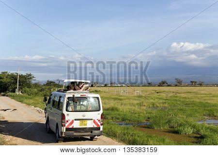 AFRICA, KENYA, MAY, 05, 2016 - Visitors on jeep shoot near Mount Kilimanjaro in Amboseli National Park at Rift Valley Province of Kenya.