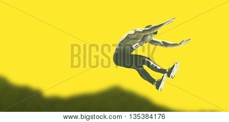 Portrait of sportsman is jumping against yellow background