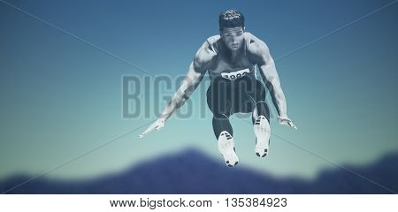 Composite image of sportsman is jumping against dark blue green background