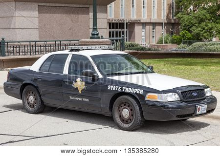 AUSTIN USA - APR 10: The State Trooper Texas Highway Patrol Police Car parked at the Texas State Capitol in Austin. April 10 2016 in Austin Texas USA
