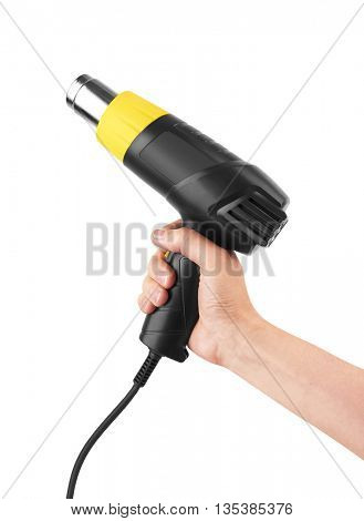 Heat gun in hand, isolated in a white background