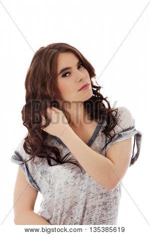 Beautiful young woman touching her dark hair