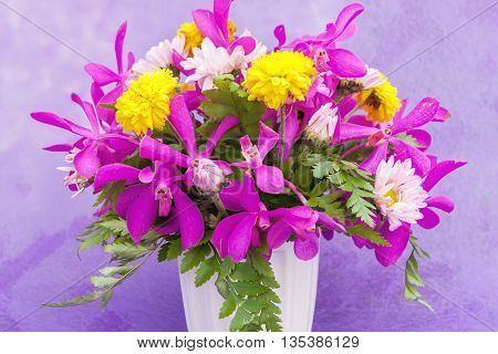 Bouquet Of Chrysanthemum And Orchid Flowers Isolated On Purple Violet Background