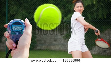 Composite image of a woman holding a chronometer to measure tennis player performance