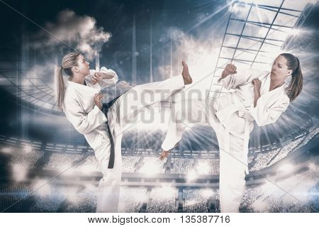 Female athlete practicing judo against overhead view of playing field