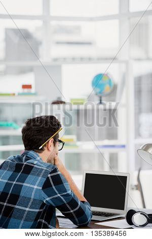Young man working at his desk in the office
