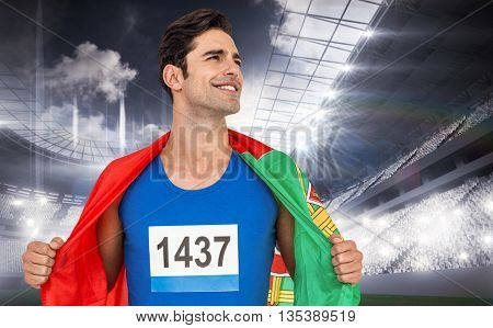 Athlete with portugal flag wrapped around his body against sports arena