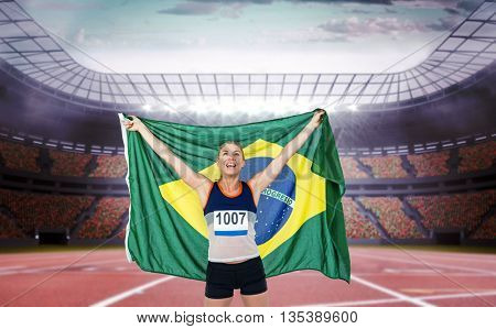 Athlete posing with brazilian flag after victory against race track