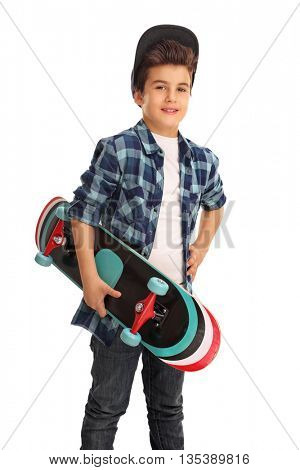 Vertical shot of a skater boy posing with a skateboard isolated on white background