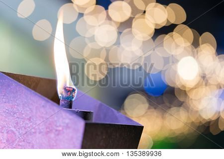 Flaming torch or candle in garden beautiful bokeh background macro close-up shot