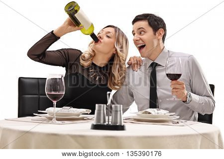 Couple drinking wine directly from the bottle seated on a date isolated on white background