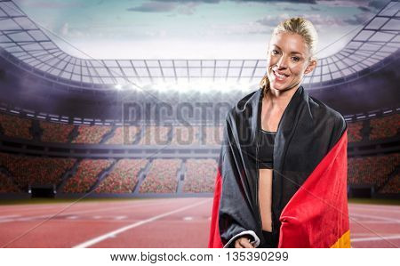 Athlete posing with German flag in a stadium