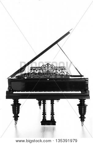Beautiful black piano in the light room