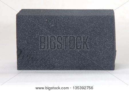 black sponge surface for cleaning on white background