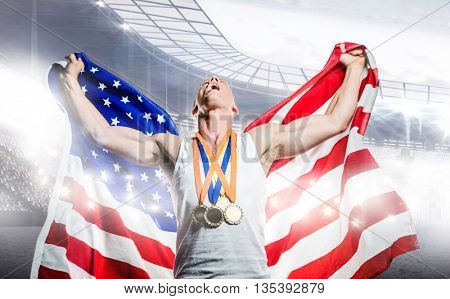 Athlete posing with American flag and gold medals after victory against sports arena