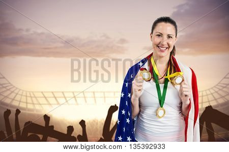 Athlete posing with gold medals after victory against stadium with cheering crowd