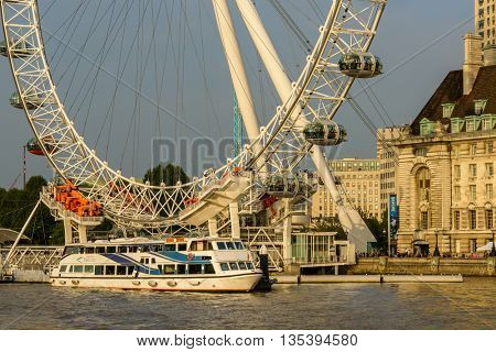 LONDON, UK - CIRCA SEPTEMBER 2013: The London Eye and the London Eye Pier on the south bank of the river Thames.