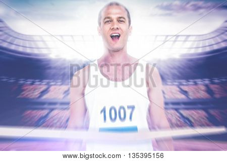 young muscular athlete man against race track