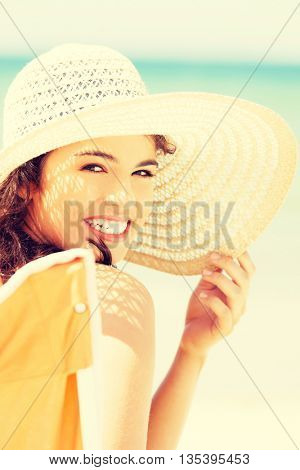 Woman on seaside at sunny day.