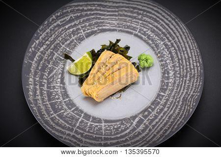 Japanese Cuisine. Sushi. Tomago  Sashimi On A Round Plate