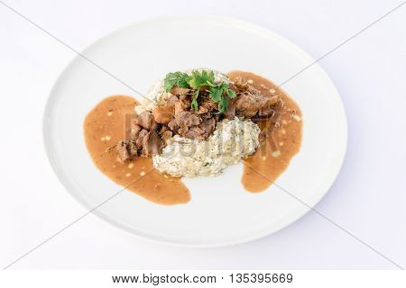 Rooster in red wine with cottage cheese-dill potatoes