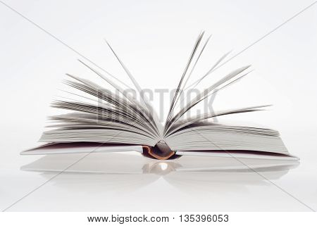 open a book on white wood background