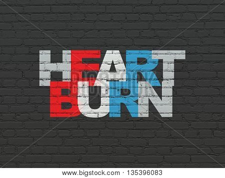 Health concept: Painted multicolor text Heartburn on Black Brick wall background