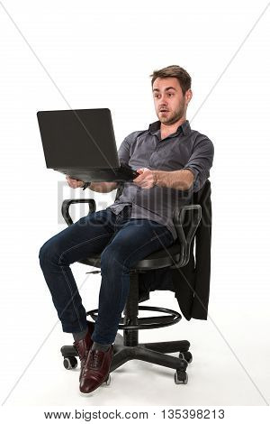 clerk enjoys working with a laptop in hand, sitting on a chair, studio white background