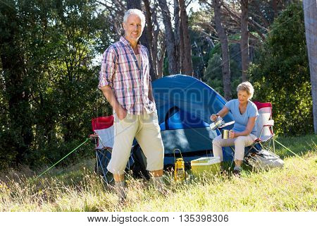 Mature couple posing on their campsite