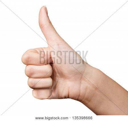 Closeup of female hand showing thumbs up sign isolated on white background