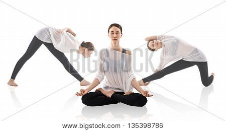 Young woman doing yoga exercise isolated over white background