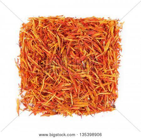 Square of dried saffron on white background