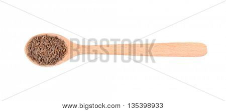 Cumin seeds in spoon on white background