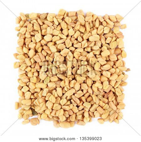 Square of fenugreek seeds on white background