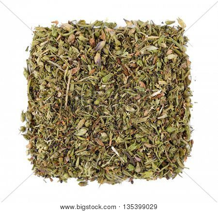 Square of dried tarragon on white background
