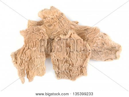 Dried ginger slices isolated on white