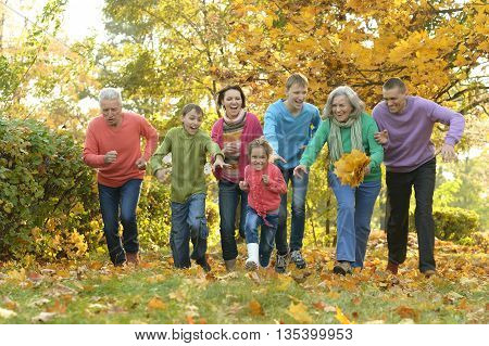 Happy Family resting in a autumn park